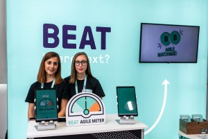 Two representatives of People Operations Team at the Beat Stand during Agile Summit Greece 2019